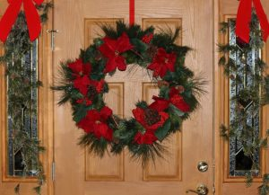 Door decorated with christmas wreath