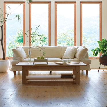 living room with large wood windows