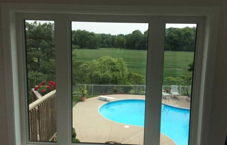 fixed interior window looking out at pool